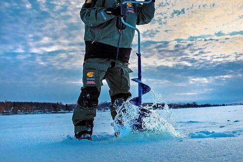 Guy Using Hand Auger For Ice Fishing