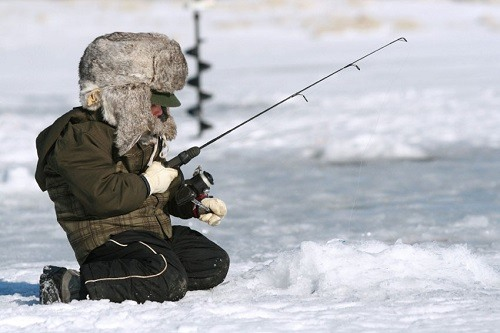 Little Boy Enjoying Ice Fishing